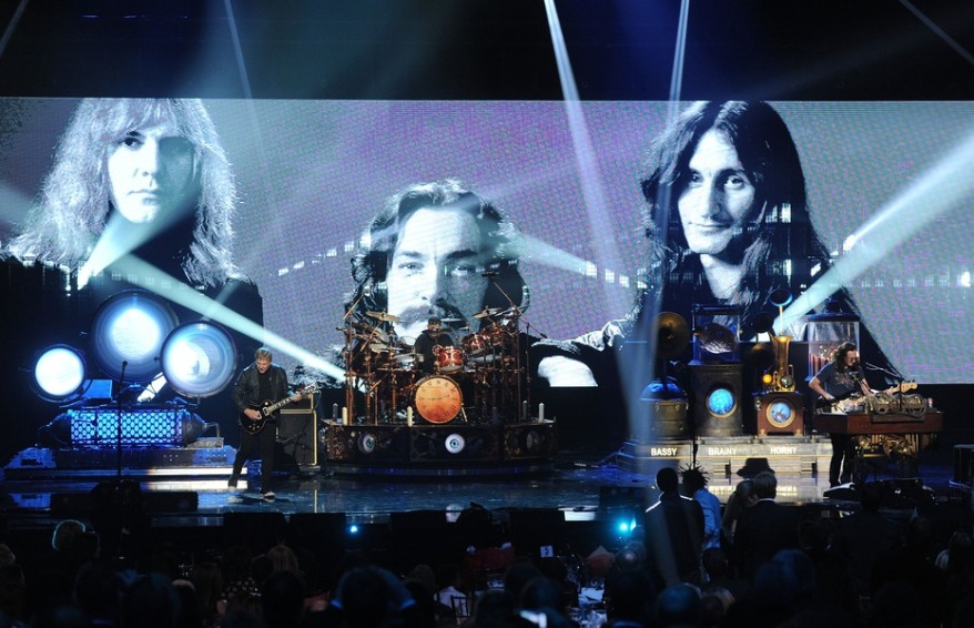 LOS ANGELES, CA - APRIL 18:  (L-R) Inductee Alex Lifeson, Neil Peart, and Geddy Lee of Rush perform on stage at the 28th Annual Rock and Roll Hall of Fame Induction Ceremony at Nokia Theatre L.A. Live on April 18, 2013 in Los Angeles, California.  (Photo by Kevin Winter/Getty Images)